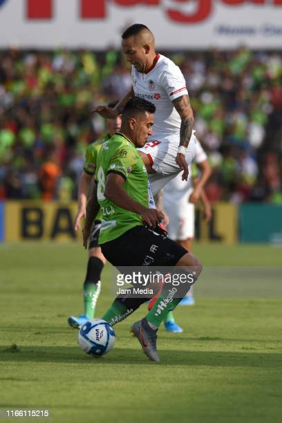 Dario Lezcano of Juarez fights for the ball with Rodrigo Salinas of Toluca during the 3rd round match between FC Juarez and Toluca as part of the...