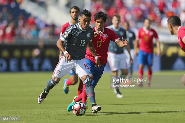 Dario Lezcano of Paraguay and Yeltsin Tejeda of Costa Rica are seen on the pitch during the 2016 Copa America Centenario Group A match between Costa...