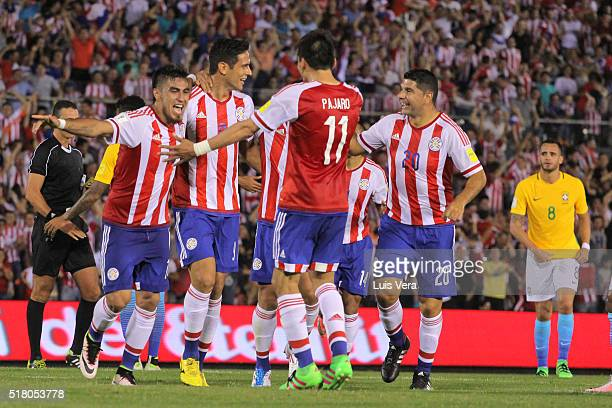 Dario Lezcano of Paraguay celebrates with teammates after scoring the first goal of his team during a match between Paraguay and Brazil as part of...
