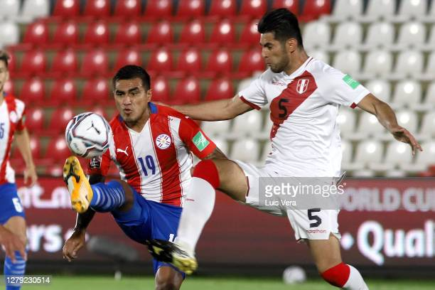 Dario Lezcano of Paraguay fights for the ball with Carlos Zambrano of Peru during a match between Paraguay and Peru as part of South American...