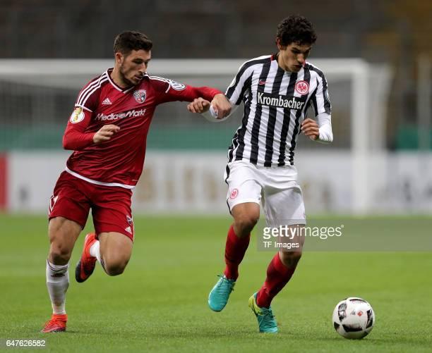 Dario Lezgano of Ingolstadt , Jesús Vallejo of Frankfurt battle for the ball during the Bundesliga match between TSG 1899 Hoffenheim and Hertha BSC...
