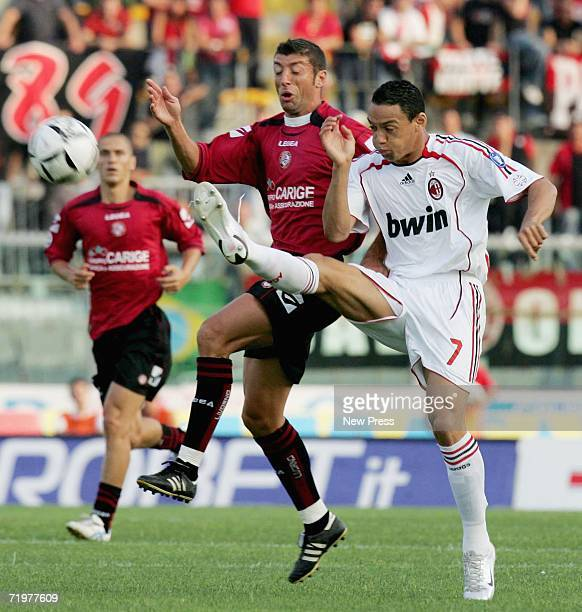 Dario Passoni of Livorno and Ricardo Oliviera of Milan compete for the ball during the Serie A match between Livorno and AC Milan at the Stadio...