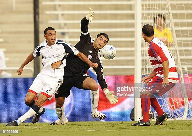 Dario Sala of the FC Dallas tries to make a save with pressure from Amaechi Igwe of the New England Revolution as Daniel Hernandez of the FC Dallas...