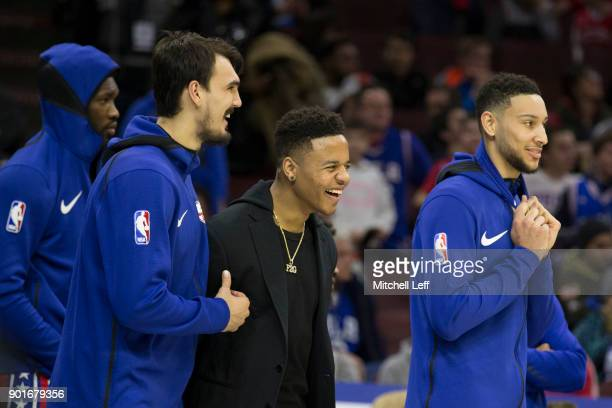 Dario Saric Markelle Fultz Joel Embiid and Ben Simmons of the Philadelphia 76ers react from the bench against the Detroit Pistons in the fourth...