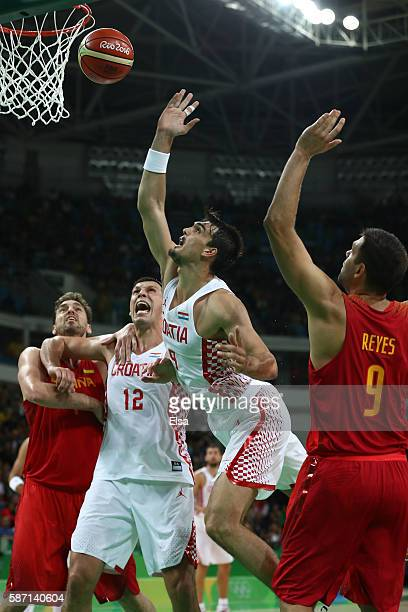 Dario Saric of Croatia shoots the ball over Felipe Reyes of Spain during a Men's preliminary round basketball game between Croatia and Spain on Day 2...