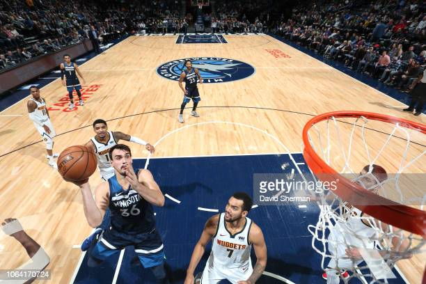 Dario Saric of the Minnesota Timberwolves shoots the ball against the Denver Nuggets on November 21 2018 at Target Center in Minneapolis Minnesota...