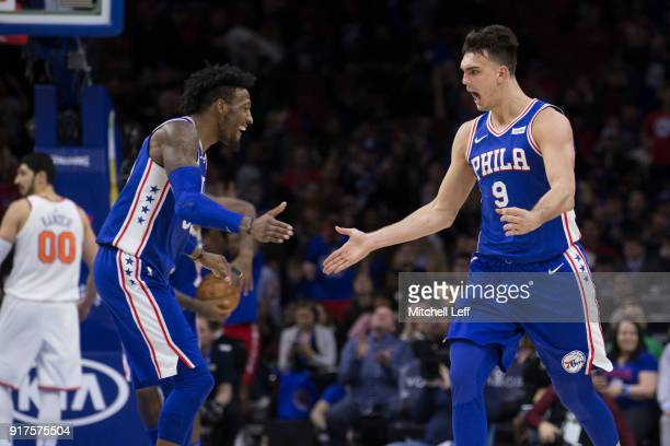 Dario Saric of the Philadelphia 76ers celebrates with Robert Covington after making a three point basket in the fourth quarter against the New York...
