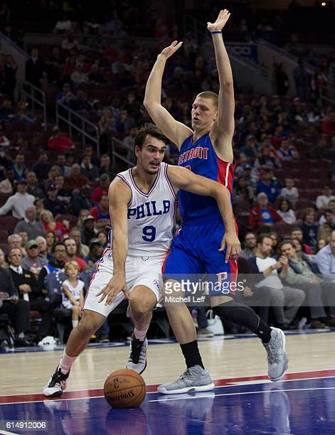 Dario Saric of the Philadelphia 76ers controls the ball against Henry Ellenson of the Detroit Pistons in the first half at Wells Fargo Center on...