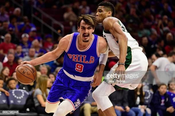 Dario Saric of the Philadelphia 76ers drives against Giannis Antetokounmpo of the Milwaukee Bucks during the first quarter at the Wells Fargo Center...