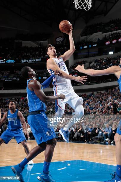 Dario Saric of the Philadelphia 76ers drives to the basket against the Dallas Mavericks on October 28 2017 at the American Airlines Center in Dallas...