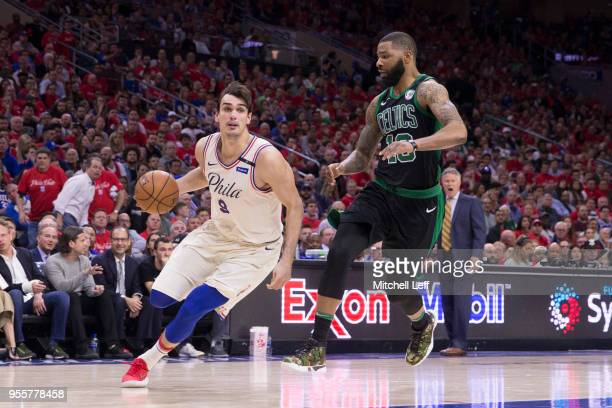 Dario Saric of the Philadelphia 76ers drives to the basket against Marcus Morris of the Boston Celtics in the fourth quarter during Game Four of the...