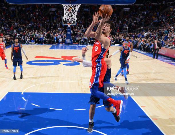Dario Saric of the Philadelphia 76ers goes up for the layup against the Oklahoma City Thunder at Wells Fargo Center on December 15 2017 in...