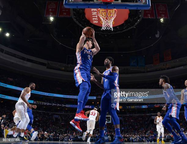 Dario Saric of the Philadelphia 76ers grabs the rebound against the Indiana Pacers at the Wells Fargo Center on March 13 2018 in Philadelphia...