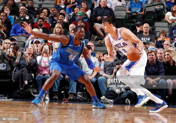 Dario Saric of the Philadelphia 76ers handles the ball against Harrison Barnes of the Dallas Mavericks during the game on October 28 2017 at the...