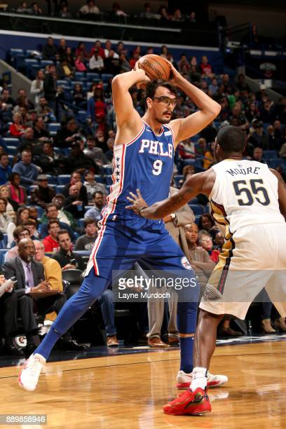 Dario Saric of the Philadelphia 76ers handles the ball against the New Orleans Pelicans on December 10 2017 at the Smoothie King Center in New...