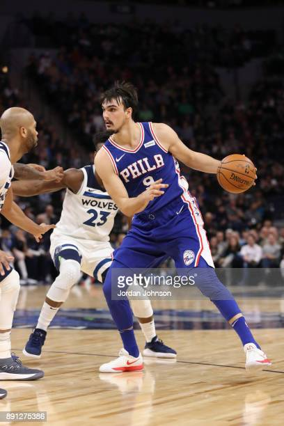 Dario Saric of the Philadelphia 76ers handles the ball against the Minnesota Timberwolves on December 12 2017 at Target Center in Minneapolis...