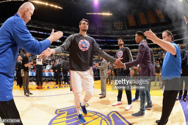 Dario Saric of the Philadelphia 76ers high fives his teammates and fans before the game against the Los Angeles Lakers on November 15 2017 at STAPLES...