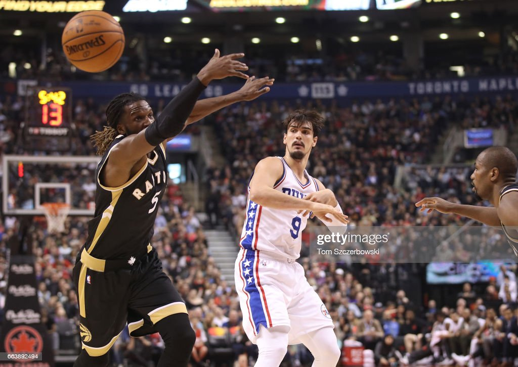 Dario Saric #9 of the Philadelphia 76ers passes the ball as DeMarre Carroll #5 of the Toronto Raptors attempts to defend during NBA game action at Air Canada Centre on April 2, 2017 in Toronto, Canada.