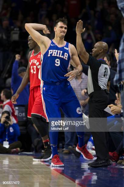 Dario Saric of the Philadelphia 76ers reacts after making a three point basket against Pascal Siakam of the Toronto Raptors in the fourth quarter at...