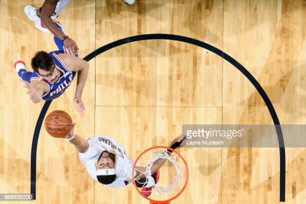 Dario Saric of the Philadelphia 76ers shoots the ball against Anthony Davis of the New Orleans Pelicans on December 10 2017 at the Smoothie King...