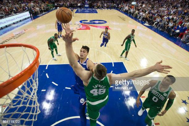 Dario Saric of the Philadelphia 76ers shoots the ball against Aron Baynes of the Boston Celtics in the third quarter at the Wells Fargo Center on...