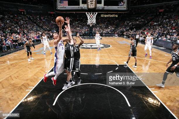 Dario Saric of the Philadelphia 76ers shoots the ball during the game against the Brooklyn Nets on March 11 2018 at Barclays Center in Brooklyn New...