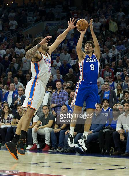 Dario Saric of the Philadelphia 76ers takes a shot against Steven Adams of the Oklahoma City Thunder in the first quarter at Wells Fargo Center on...