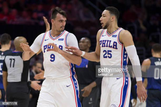 Dario Saric of the Philadelphia 76ers talks to Ben Simmons during a timeout in the first quarter against the Orlando Magic at the Wells Fargo Center...