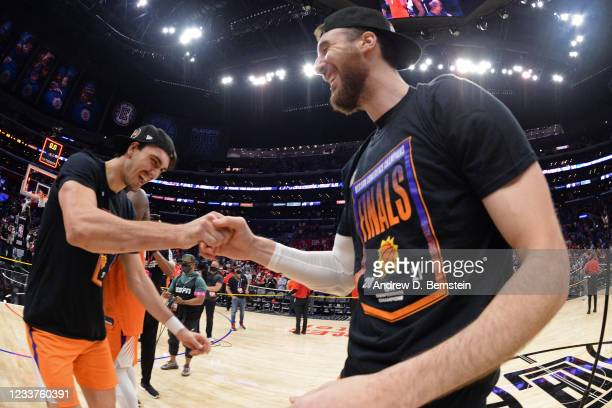 Dario Saric of the Phoenix Suns fist bumps Frank Kaminsky of the Phoenix Suns after the game against the LA Clippers during Game 6 of the Western...