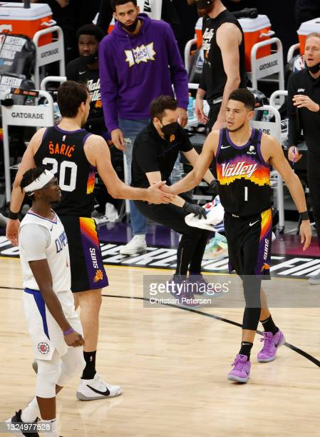 Dario Saric of the Phoenix Suns high fives Devin Booker during the fourth quarter in game two of the NBA Western Conference finals at Phoenix Suns...