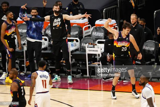 Dario Saric of the Phoenix Suns reacts to a three-point shot against the Denver Nuggets during the first half in Game Two of the Western Conference...