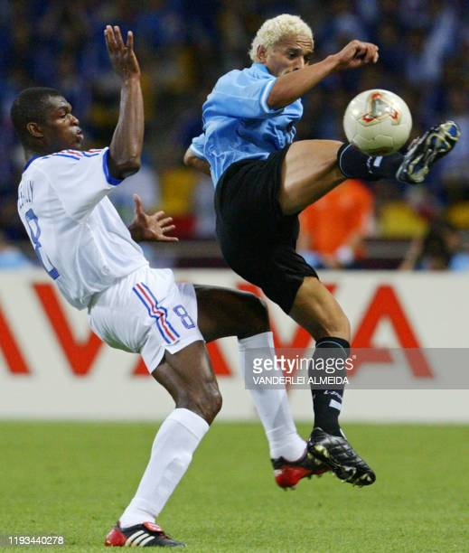 Dario Silva of Uruguay beats French defender and captain Marcel Desailly to the ball, 06 June 2002 at the Busan Asiad Main Stadium in Busan, during...