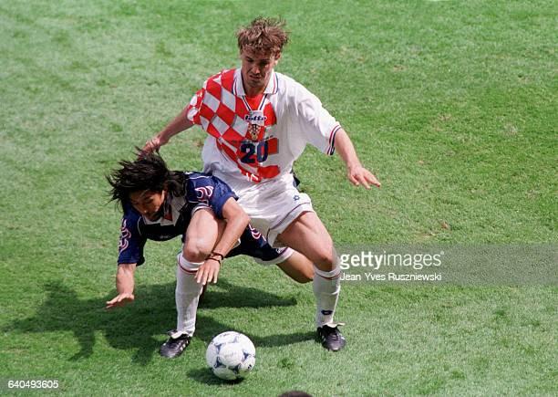 Dario Simic and Masayuki Okano during the Japan vs Croatia soccer game at the 1998 soccer World Cup