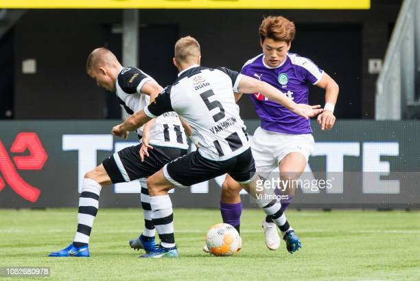Dario van den Buijs of Heracles Almelo Bart van Hintum of Heracles Almelo Ritsu Doan of FC Groningen during the Dutch Eredivisie match between...