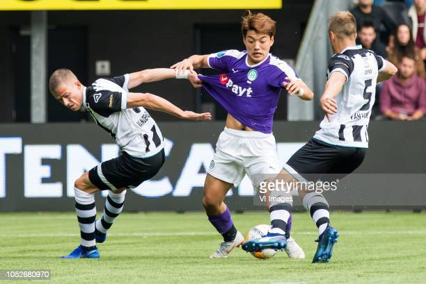 Dario van den Buijs of Heracles Almelo Ritsu Doan of FC Groningen Bart van Hintum of Heracles Almelo during the Dutch Eredivisie match between...