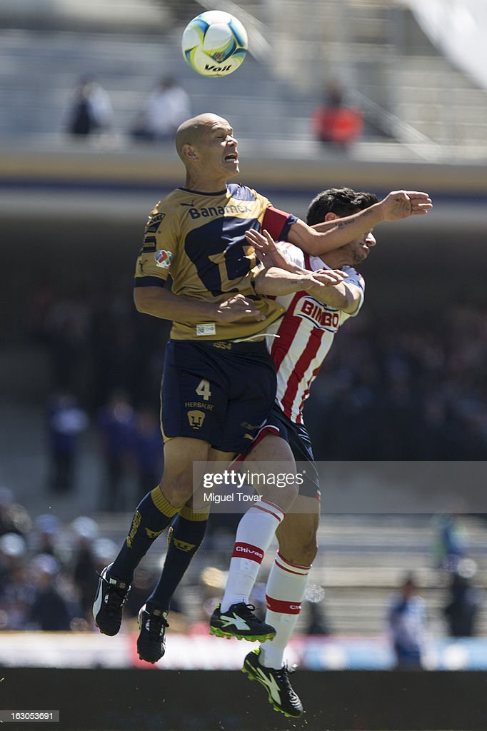 Dar'io Veron of Pumas fights for the ball with Rafael Marquez of Chivas during a match between Pumas and Chivas as part of the Clausura 2013 at Olympic stadium on March 03, 2013 in Mexico City, Mexico.