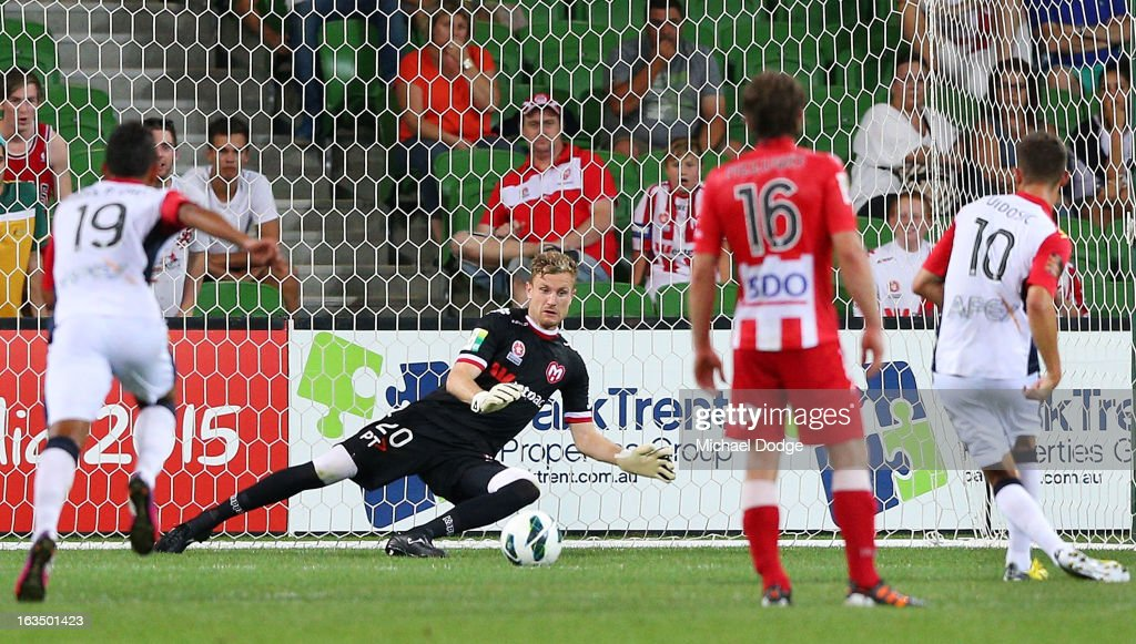 Dario Vidosic of Adelaide United kicks the ball and scores a penalty goal past Andrew Redmayne of the Heart during the round 24 A-League match between the Melbourne Heart and Adelaide United at AAMI Park on March 11, 2013 in Melbourne, Australia.
