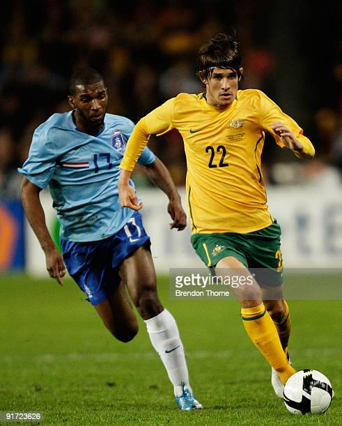 Dario Vidosic of Australia competes with Ryan Babel of the Netherlands during the international friendly match between Australia and the Netherlands...