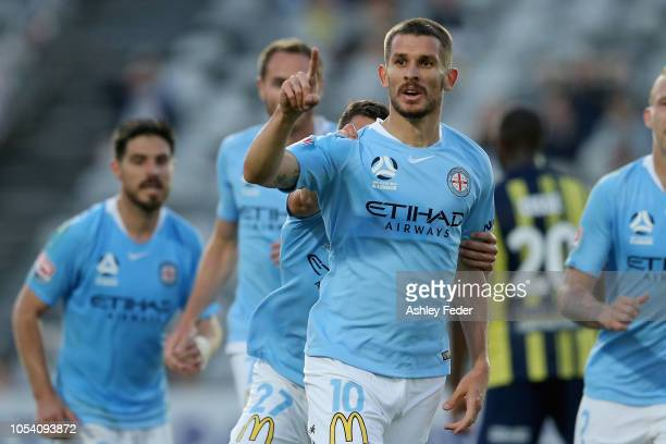 Dario Vidosic of Melbourne City celebrates his goal with team mates during the round two ALeague match between the Central Coast Mariners and...