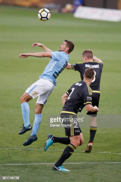 Dario Vidosic of Melbourne City heads rhe ball during the round 14 ALeague match between Melbourne City and the Wellington Phoenix at AAMI Park on...