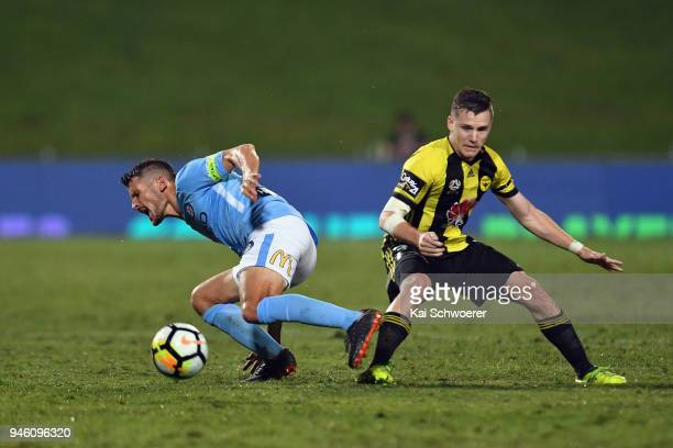 Dario Vidosic of Melbourne City is tackled by Scott Galloway of the Phoenix during the round 27 ALeague match between the Wellington Phoenix and...