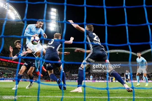 Dario Vidosic of the City heads the ball for a goal during the round nine ALeague match between Melbourne City and Melbourne Victory at AAMI Park on...