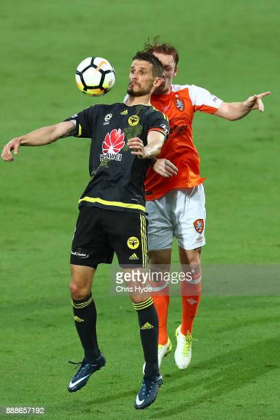 Dario Vidosic of the Phoenix and Corey Brown of the Roar compete for the ball during the round 10 ALeague match between the Brisbane Roar and the...