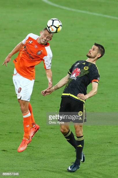 Dario Vidosic of the Phoenix and Daniel Bowles of the Roar compete for the ball during the round 10 ALeague match between the Brisbane Roar and the...