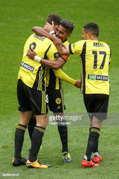 Dario Vidosic of the Phoenix celebrates with Roy Krishna and Ali Abbas after scoring a goal during the round one ALeague match between Wellington...