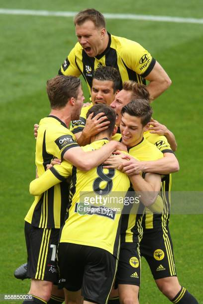 Dario Vidosic of the Phoenix celebrates with teammates after scoring a goal during the round one ALeague match between Wellington Phoenix and...
