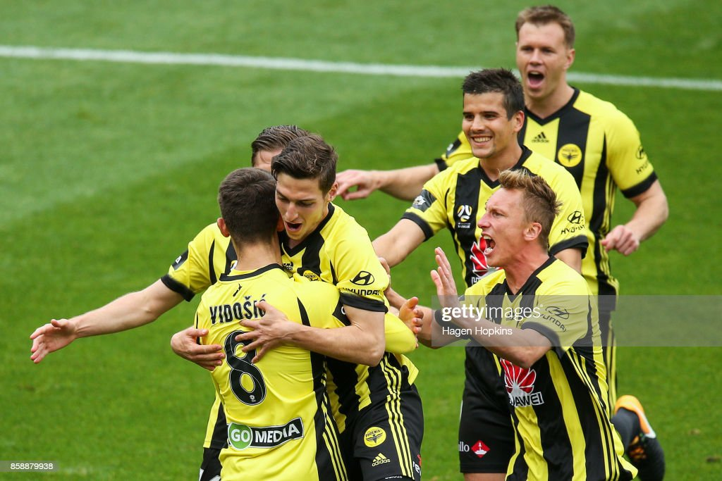 Dario Vidosic of the Phoenix celebrates with teammates after scoring a goal during the round one A-League match between Wellington Phoenix and Adelaide United at Westpac Stadium on October 8, 2017 in Wellington, New Zealand.