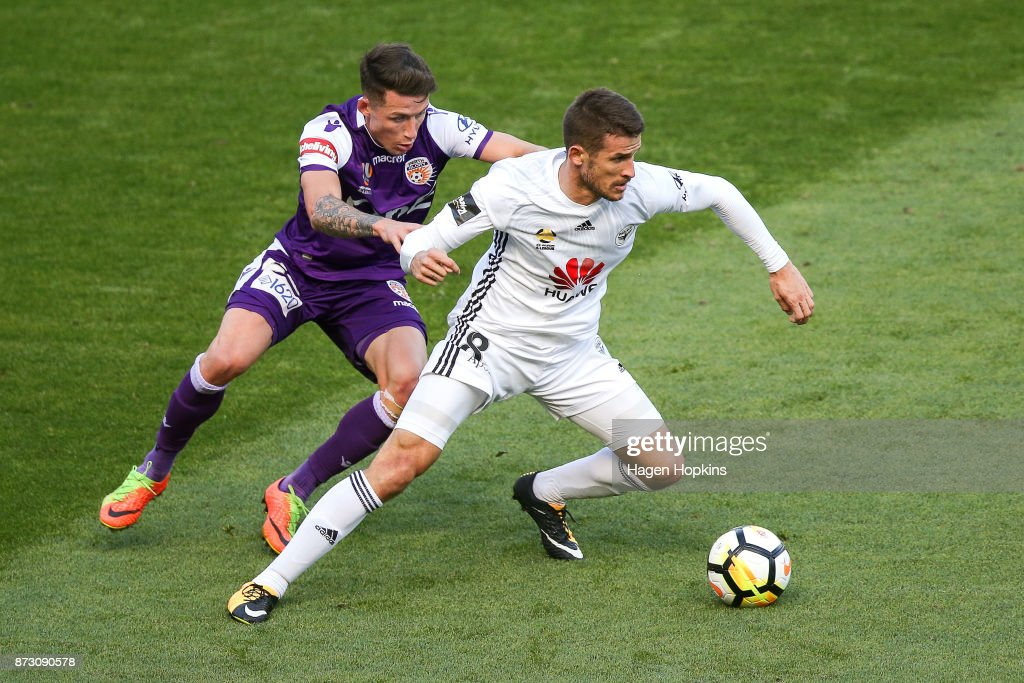 Dario Vidosic of the Phoenix holds off the challenge of Scott Neville of the Glory during the round six A-League match between the Wellington Phoenix and the Perth Glory at Westpac Stadium on November 12, 2017 in Wellington, New Zealand.