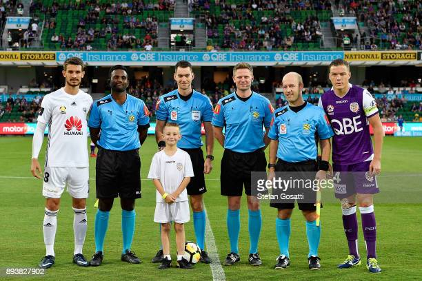 Dario Vidosic of the Phoenix poses with the referees and Shane Lowry of the Glory before the round 11 ALeague match between the Perth Glory and the...