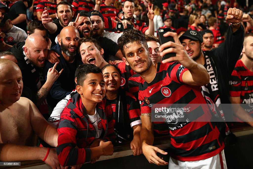 Dario Vidosic of the Wanderers poses with fans after winning the A-League Semi Final match in extra time between the Western Sydney Wanderers and the Brisbane Roar at Pirtek Stadium on April 24, 2016 in Sydney, Australia.